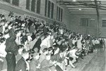 Bridgewater College, People cheer in stands at Alumni Gymnasium, undated by Bridgewater College