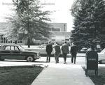 Bridgewater College, Students preparing to cross East College Street toward Alumni Gymnasium, undated by Bridgewater College
