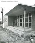 Bridgewater College, Two students at Alumni Gymnasium, circa 1957 by Bridgewater College