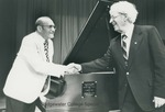 Bridgewater College, Nevin Fisher, pianist, shaking hands with Nelson T. Huffman at the dedicatory concert for the Steinway piano that Dr. and Mrs. Huffman donated, 24 May 1980 by Bridgewater College