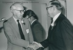 Bridgewater College, Dr. William L. Brown (left) shaking hands with President Wayne F. Geisert after winning the Distinguished Alumnus award, 1981 by Bridgewater College