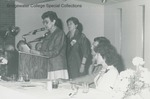 Bridgewater College, Margaret Flory Wampler, at podium, reading Distinguished Alumnus award citation to winner Dr. Edith Kern (behind), May 1985 by Bridgewater College