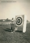 Bridgewater College, A student removing arrows from an archery target, undated by Bridgewater College