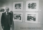 Bridgewater College, BC graduate and artist Isaac J. Sanger with some of his prints, undated by Bridgewater College