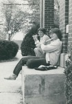 Bridgewater College, Two students sitting on steps playing flutes, 1981 by Bridgewater College