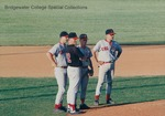 Bridgewater College, baseball players standing on field with Head Coach Curt Kendall, circa 1994 by Bridgewater College
