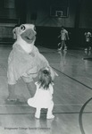 Bridgewater College, Ernie the Eagle interacting with a child on the basketball court, circa 1992 by Bridgewater College