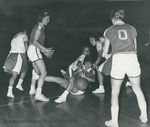 Bridgewater College Women's varsity basketball, Precious Brady and Barbara Purkey move in to assist Yonnie Kauffman, circa 1965 by Bridgewater College