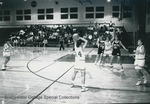 Bridgewater College women's basketball action photograph featuring Angie Vizachero, 1992 by Bridgewater College