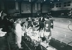 Bridgewater College women's basketball team meeting on the sideline with Coach Laura Mapp, 1992 by Bridgewater College
