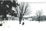 Bridgewater College, Students crossing campus mall in snow with Blue Ridge Hall and farm in background, undated by Bridgewater College