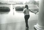 Bridgewater College, Students leaving Bowman Hall in rain with Blue Ridge Hall in background, undated by Bridgewater College