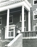 Bridgewater College, Students in beanies talk on steps of Blue Ridge Hall, undated by Bridgewater College