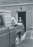 Bridgewater College, Librarian Orland Wages preparing to load a box of books on the truck from Cole Hall to the new Alexander Mack Memorial Library, 18 Sept 1963 by Bridgewater College