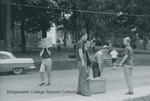 Bridgewater College, Students carrying books to the new Alexander Mack Memorial Library, 18 Sept 1963 by Bridgewater College