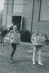 Bridgewater College, students carrying books out of the old gymansium for the new Alexander Mack Memorial Library, 18 Sept 1963 by Bridgewater College