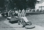 Bridgewater College, men moving a bookcase with a Gravely tractor mower, 18 Sept 1963 by Bridgewater College