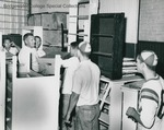 Bridgewater College, The football squad receiving instructions on removing books from the old gymnasium, 18 Sept 1963 by Bridgewater College