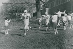 Bridgewater College, cheerleaders with football players rushing the field, circa 1965 by Bridgewater College