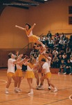 Bridgewater College, cheerleaders performing a stunt, circa 1988 by Bridgewater College