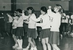 Bridgewater College, cheerleaders cheering at a basketball game, circa 1976 by Bridgewater College