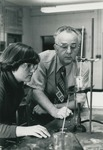 Bridgewater College, A student and Dr. John Martin in the chemistry lab, undated by Bridgewater College
