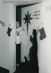 Bridgewater College, A student with a residence hall room door decorated for Christmas, undated by Bridgewater College