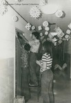 Bridgewater College, Students decorating a residence hall room door for Christmas, undated by Bridgewater College