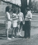 Bridgewater College, Three students talking with Dr. James Eaton, May 1986 by Bridgewater College
