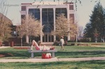 Bridgewater College, Student resting on bench outside Cole Hall, 1991 by Bridgewater College