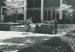 Bridgewater College, Two students outside Cole Hall, one is riding a bicycle, 1979 by Bridgewater College