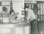 Bridgewater College, Student and librarian in BC library in Cole Hall basement, undated by Bridgewater College