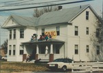 Bridgewater College, Women who lived in the Farm House watching the Homecoming parade from its porch roof with Halloween ghost hanging below, 29 October 1988 by Bridgewater College