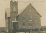Unidentified group, probably congregation, standing in front of Bridgewater Church of the Brethren, early 20th century by Bridgewater College