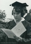Bridgewater College, A graduate reading the commencement program, 1981 by Bridgewater College
