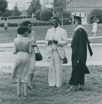 Bridgewater College, A professor talking with a family at commencement, 1982 by Bridgewater College