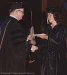 Bridgewater College, An unidentified student is presented her diploma at commencement, 1982 by Bridgewater College