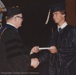 Bridgewater College, An unidentified student is presented his diploma at commencement, 1982 by Bridgewater College
