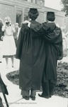 Bridgewater College, Photograph from behind of two graduates posing for a picture, 29 May 1983 by Bridgewater College