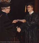 Bridgewater College, A student receiving his diploma from President Wayne F. Geisert, 29 May 1983 by Bridgewater College