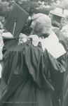 Bridgewater College, Graduates embracing at commencement, May 1984 by Bridgewater College