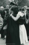 Bridgewater College, A graduate and a woman embracing, May 1984 by Bridgewater College