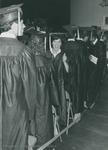 Bridgewater College, Graduate Kathy Gower giving a thumbs up in the graduation line, May 1986 by Bridgewater College
