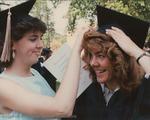 Bridgewater College, Close up photograph of graduates adjusting regalia, 1987 by Bridgewater College
