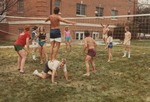 Bridgewater College, Volleyball game at Dillon Hall beach party with Bruce Meyers standing on Greg Davis, April 1985 by Bridgewater College