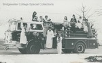 Bridgewater College, Dillon Hall First Floor East floor photograph with students in nightgowns on Bridgewater firetruck, 1980 by Bridgewater College