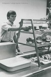 Bridgewater College, Student selects a dessert in the cafeteria line, undated by Bridgewater College
