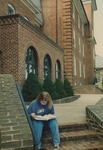 Bridgewater College, Student reading on the Flory Hall connector steps, 4 April 1996 by Bridgewater College