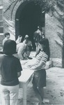 Bridgewater College, Students in beanies at sign up table at Founders' Hall entrance, undated by Bridgewater College