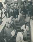 Bridgewater College, Students go up and down steps to the mail boxes in Founders' Hall basement, circa 1963 by Bridgewater College